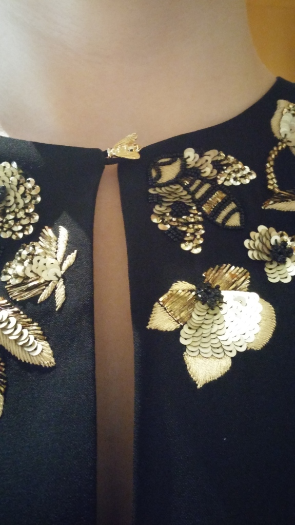 Gold sequins detailing flowers, bees and dragonflies
